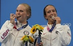 Delaney Schnell and Jessica Parratto, right, posed with their silver medals Tuesday in Tokyo.