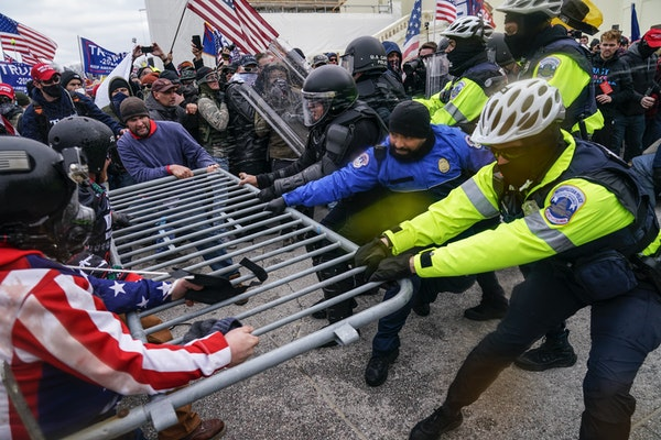 Trump supporters beset a police barrier at the Capitol in Washington on Jan. 6.