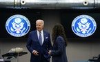 President Joe Biden talks with National Counterterrorism Center Director Christy Abizaid during a visit to the Office of the Director of National Inte
