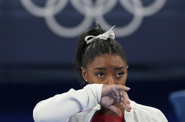 Simone Biles watched her U.S. teammates perform in the women's team final Tuesday in Tokyo.