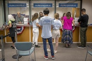 A group of seven women filled out forms to run as park board candidates Tuesday at the Public Service Center.