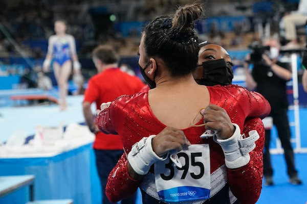 Simone Biles hugged teammate Suni Lee after Biles pulled out of the women's gymnastic team finals Tuesday in Tokyo. Lee, from St. Paul, assumed the