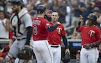 Twins catcher Mitch Garver (8) celebrated with Brent Rooker (50) and Jorge Polanco (11) after hitting a first-inning grand slam against the Tigers on