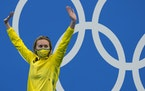 Austrailia's Ariarne Titmus waved from the podium after winning the women's 200-meter freestyle at the Tokyo Olympics on Wednesday./
