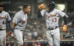 The Tigers' Eric Haase (13) celebrated his game-tying grand slam in the ninth inning with first baseman Miguel Cabrera. The Tigers beat the Twins 6-