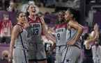 United States' Kelsey Plum, left, Stefanie Dolson (13), Jacquelyn Young (8) and Allisha Gray celebrate after defeating Russia.