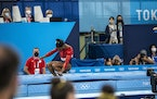 Simone Biles of the United States misses her vault landing at the women's team gymnastics final . She later withdrew from the competition.