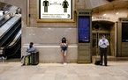 Socially distanced commuters wore face masks at Grand Central Station in Manhattan on Tuesday, July 27, 2021. Revising a decision made just two months