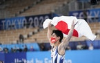 Daiki Hashimoto, of Japan, celebrates after winning the gold medal in the artistic gymnastics men's all-around final.