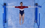 Sunisa Lee, of the United States, performs on the uneven bars during the artistic gymnastics women's final at the 2020 Summer Olympics, Tuesday, July