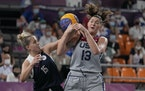 United States' Stefanie Dolson (13) and Olga Frolkina (15), of the Russian Olympic Committee, chase a loose ball during the 3-on-3 gold medal game.