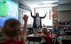 In this photo from June, first graders raised their hands to offer an answer during Katie Nelson's summer school class at Vista View Elementary in B