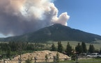 The Robertson Draw fire is seen burning south of Red Lodge, Mont., on June 15. Authorities warned of extreme wildfire danger in Montana and Wyoming Tu