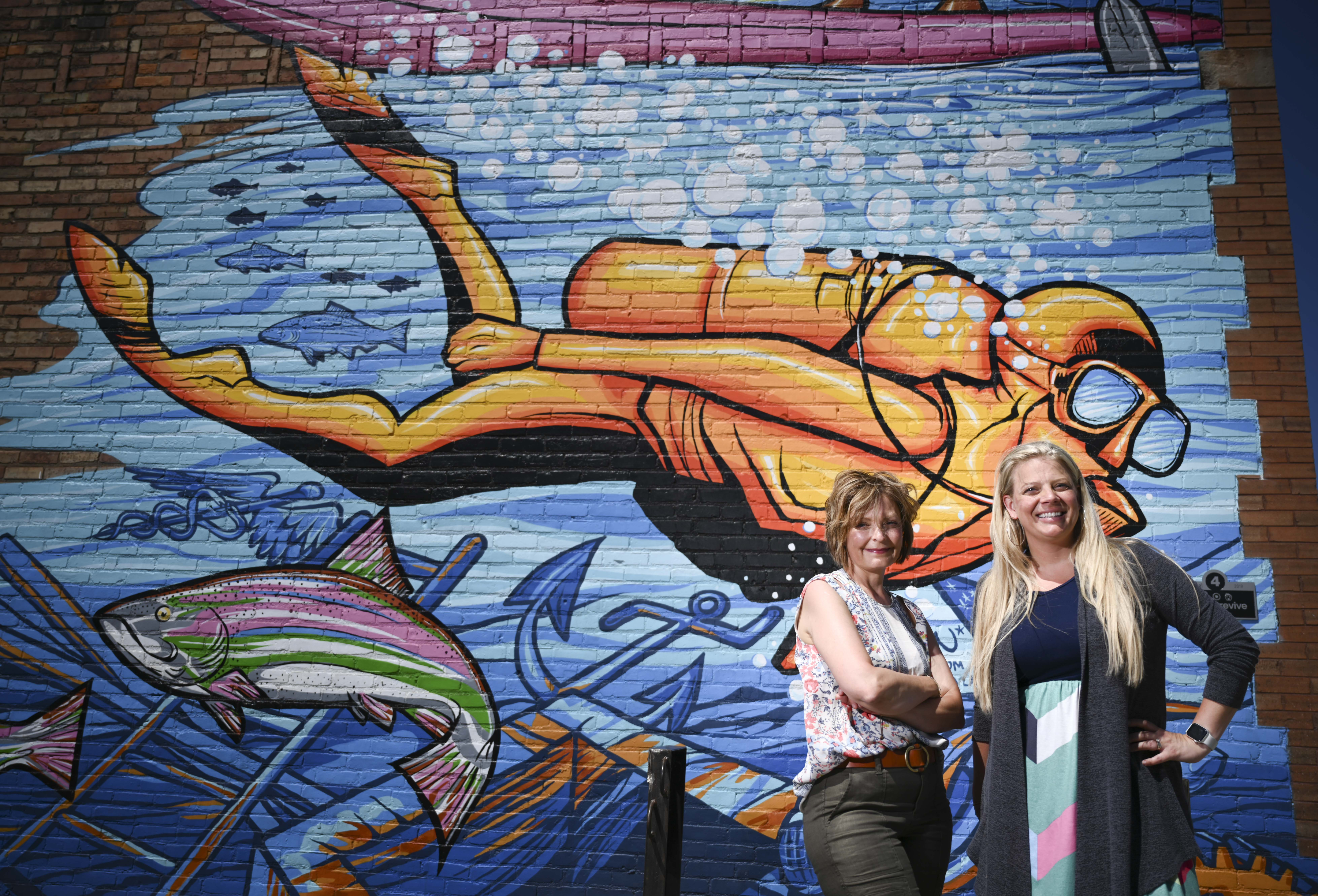 With input and buy-in from Cuyuna Lakes communities, Michelle LeMieur, left, and Johnna Johnson and other residents have led revitilization projects. One of them is public art: eight building murals.