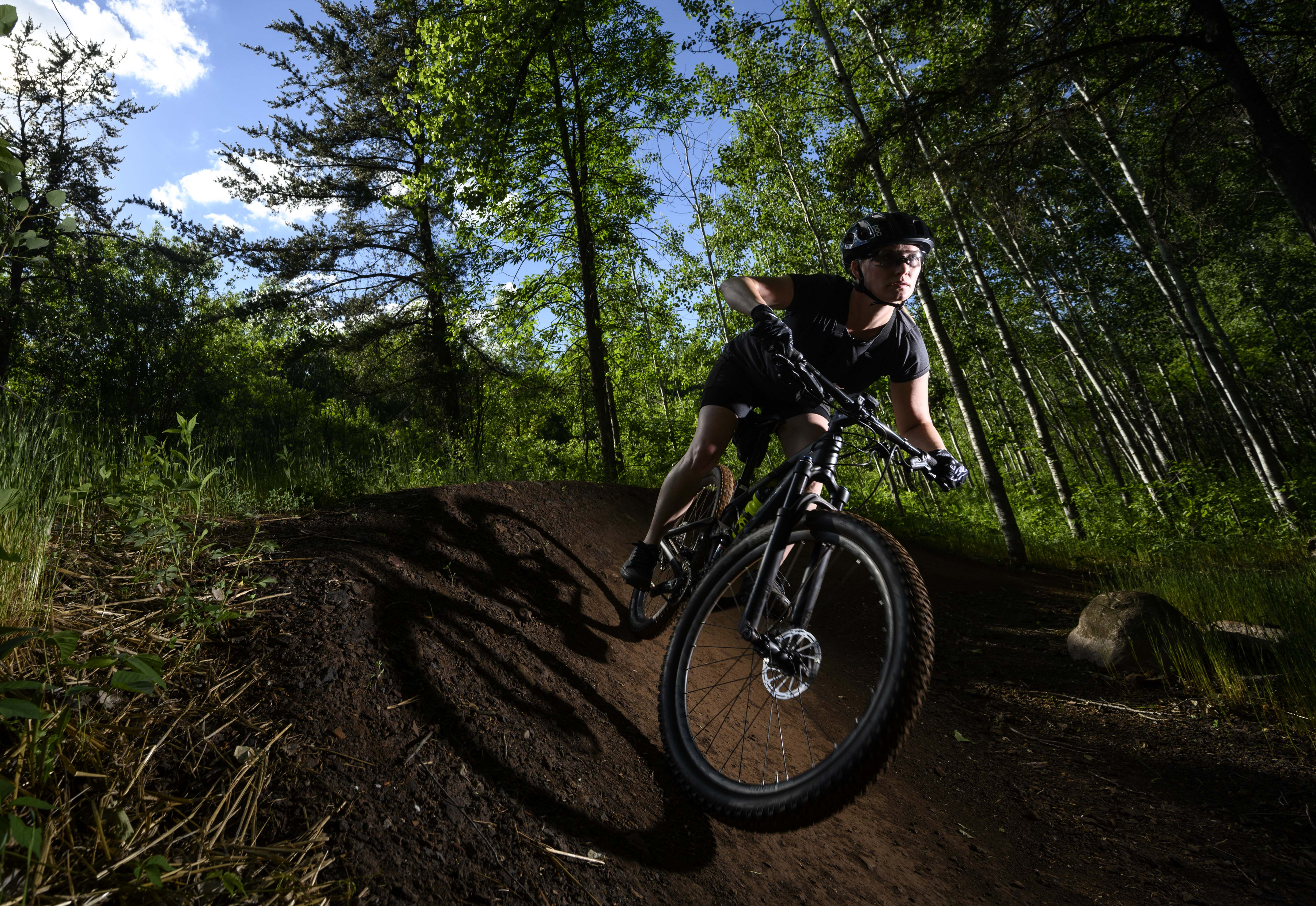 Kate Swanson cut around a berm on Drawpoint Trail in Cuyuna Country State Recreation Area.