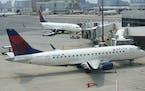 Delta Air Lines passenger jets rest on the tarmac last week at Boston Logan International Airport. (AP Photo/Steven Senne)