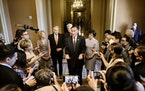 Sen. Mitt Romney (R-Utah) speaks to reporters about the infrastructure deal on Wednesday, July 28, 2021, at the Capitol in Washington as Sens. Lisa Mu