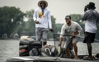 Randy Moss reacted after catching a large mouth bass during the tournament as Dane Vocelka (netting the fish) guided Moss and his friend Lee Vickers.