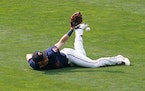 Left fielder Brent Rooker dove for a fly ball in the top of the ninth inning but could not hold it in the Twins' 17-14 loss to the Tigers at Target