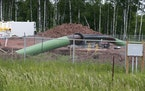 An Enbridge Energy pipeline drilling pad is shown in this June 2018 file photo along a rail line that traces the Minnesota-Wisconsin border near Cloqu