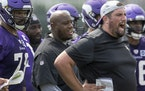 New Vikings offensive line coach Phil Rauscher during Wednesday's practice.