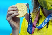 Australia's Ariarne Titmus displays her gold medal after winning the women's 200 meter freestyle finals