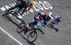 Alise Willoughby of the United States, center, is followed by Rebecca Petch of New Zealand, left, and Natalia Afremova of the Russian Olympic Committe
