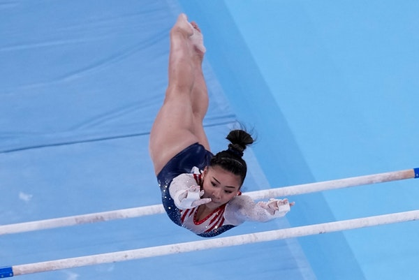 Suni Lee of St. Paul performs on the uneven bars during women's all-around final on Thursday.