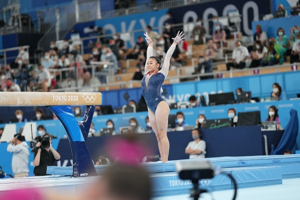 Suni Lee of the United States competes in the balance beam event during the women's all-around gymnastics competition.