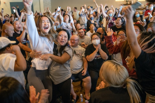 Shyenne Lee, 18, the older sister of St. Paul Olympian Suni Lee, left, reacted alongside Souayee Vang, right, and other family and friends, after Sun