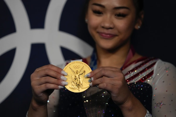 St. Paul's Suni Lee posed with her gold medal in the artistic gymnastics women's all-around final at the 2020 Summer Olympics.