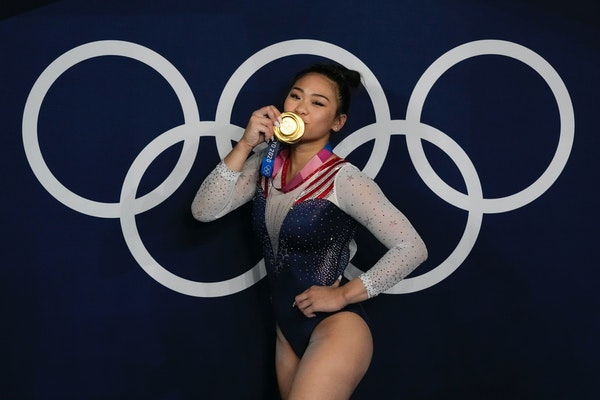 Suni Lee of St. Paul poses with her gold medal after the artistic gymnastics women's all-around final today at the Summer Olympics in Tokyo.