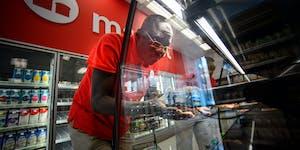 A Target employee assembled a soft drink display.
