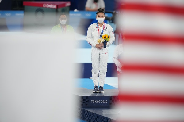Suni Lee of St. Paul stood during the medal ceremony after winning the gold medal for the women's all-around gymnastics competition.