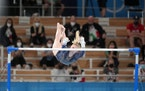 Jade Carey of the United States performs on the uneven bars during the women's all-around gymnastics competition.
