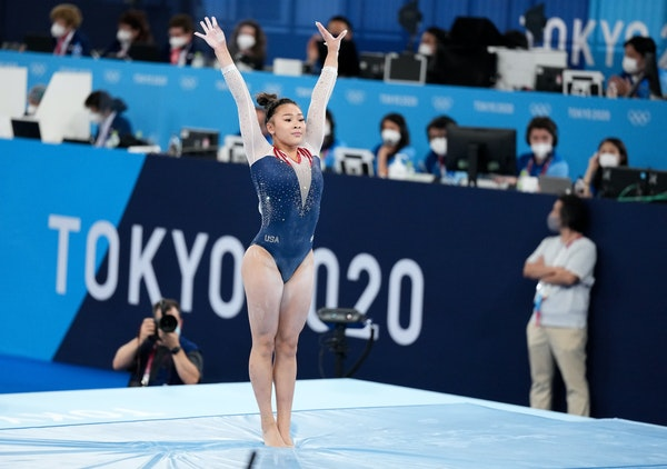 Suni Lee after landing her balance beam routine during the women's all-around gymnastics competition.