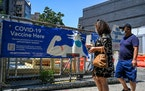 A pedestrian pointed to a sign advertising COVID-19 vaccines in New York, July 23, 2021.