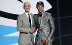 Jalen Suggs, right, posed with NBA Commissioner Adam Silver after being selected fifth overall by the Magic in Thursday's draft.