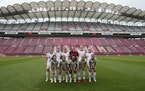 United States starting players pose for a photo prior a women's soccer match against Australia