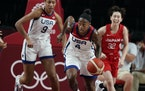 United States' Jewell Loyd brings the ball up court during women's basketball preliminary round game against Japan at the 2020 Summer Olympics