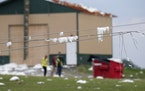 Insulation covers power lines at D and D Well and Pumps where a roof was torn off a storage shed on County Highway F in the Town of Concord, Wis., on