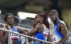 Lynna Irby of the United States wipes a tear away after the 4 x 400-meter mixed relay.