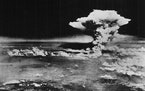 The mushroom cloud rises from Hiroshima, Japan, on Aug. 6, 1945, after the first atomic bomb was dropped by a B-29 bomber, as seen in this photo provi