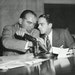 U.S. Sen. Joseph McCarthy covered the microphones while having a whispered discussion with his chief counsel Roy Cohn during the televised Army-McCart