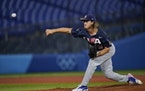 Joe Ryan pitches for the U.S. against Israel at the Tokyo Olympics.