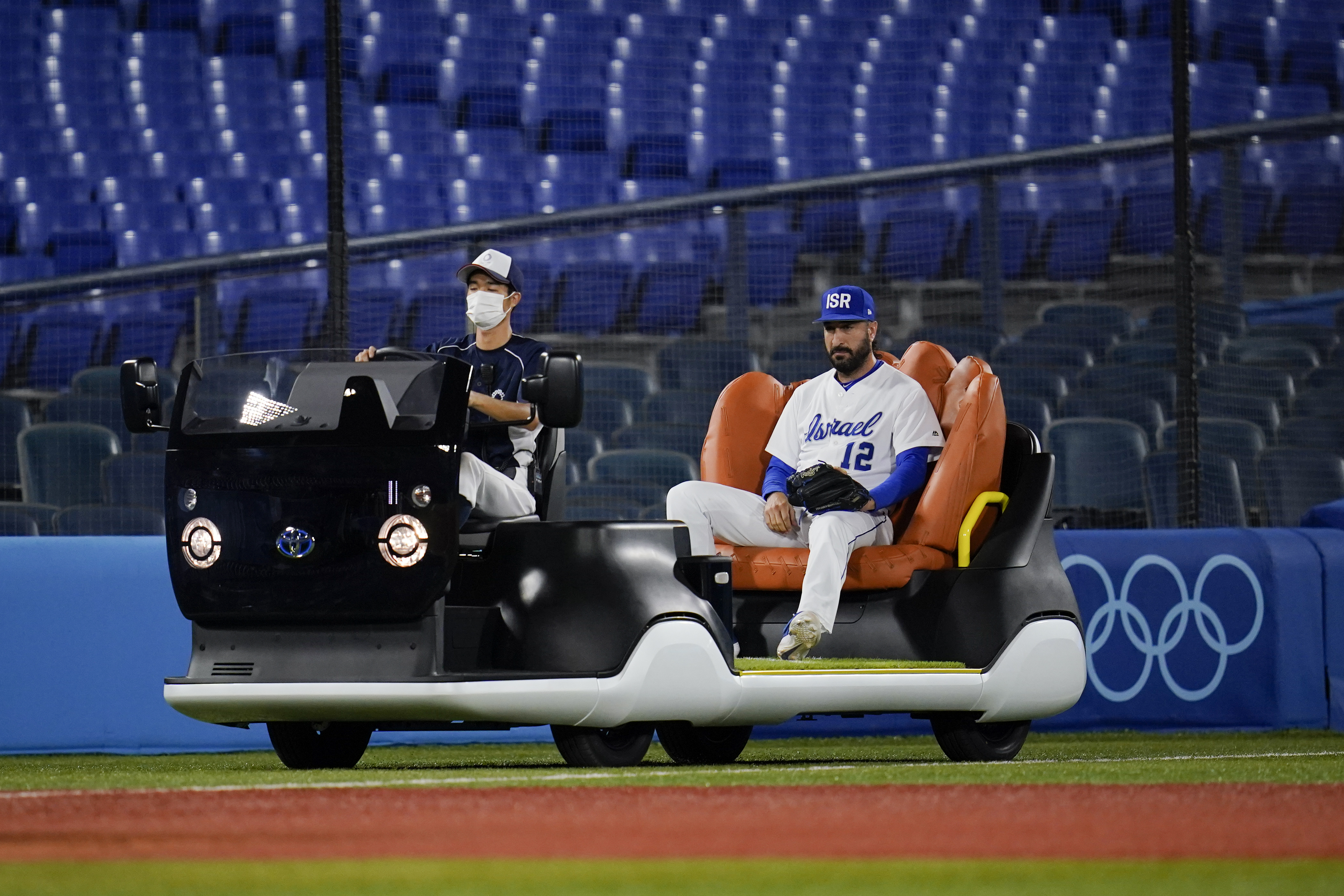 Israel's Shlomo Lipetz comes in to pitch on the bullpen cart.
