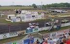 Race cars take the green flag at Fairmont Raceway in Fairmont, Minn.