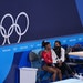 Simone Biles of the United States, left, talked with a trainer during the women's team gymnastic's final at the Tokyo Olympic Games on Tuesday. Bi