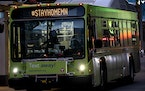 Metro Transit buses travel with the hashtag #STAYHOMEMN during the coronavirus outbreak on Nicollet Mall in downtown Minneapolis, on March 23, 2020.
