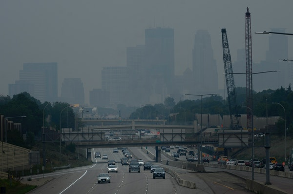 Traffic moved along the I-35W on Friday, with downtown Minneapolis enveloped by a smoky haze, as seen from the E. 46th Street overpass.